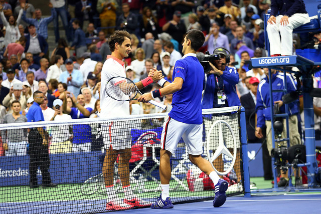 September 13, 2015 - Roger Federer shakes hands with Novak Djokovic after the men's singles final match during the 2015 US Open at the USTA Billie Jean King National Tennis Center in Flushing, NY. (USTA/Ned Dishman)