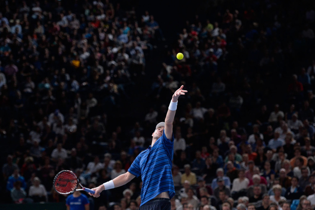 PARIS, FRANCE - NOVEMBER 05:  John Isner of the United States of America serves during his Men's 1/8 finals match against Roger Federer of Switzerland on day four of the BNP Paribas Masters at Palais Omnisports de Bercy on November 5, 2015 in Paris, France.  (Photo by Aurelien Meunier/Getty Images)