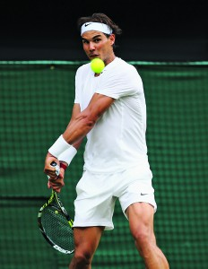 LONDON, ENGLAND - JUNE 24:  Rafael Nadal of Spain plays a backhand during his Gentlemen's Singles first round match against Martin Klizan of Slovakia on day two of the Wimbledon Lawn Tennis Championships at the All England Lawn Tennis and Croquet Club at Wimbledon on June 24, 2014 in London, England.  (Photo by Al Bello/Getty Images)