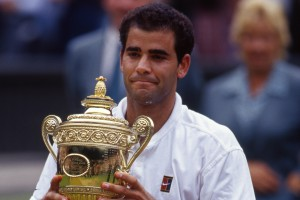 Pete Sampras (USA) holds up the trophy at the trophy presentation on Centre Court, after winning the Gentlemen's Singles final against Andre Agassi (USA), at The Championships 1999. Held at The All England Lawn Tennis Club, Wimbledon. Credit: AELTC/Michael Cole.