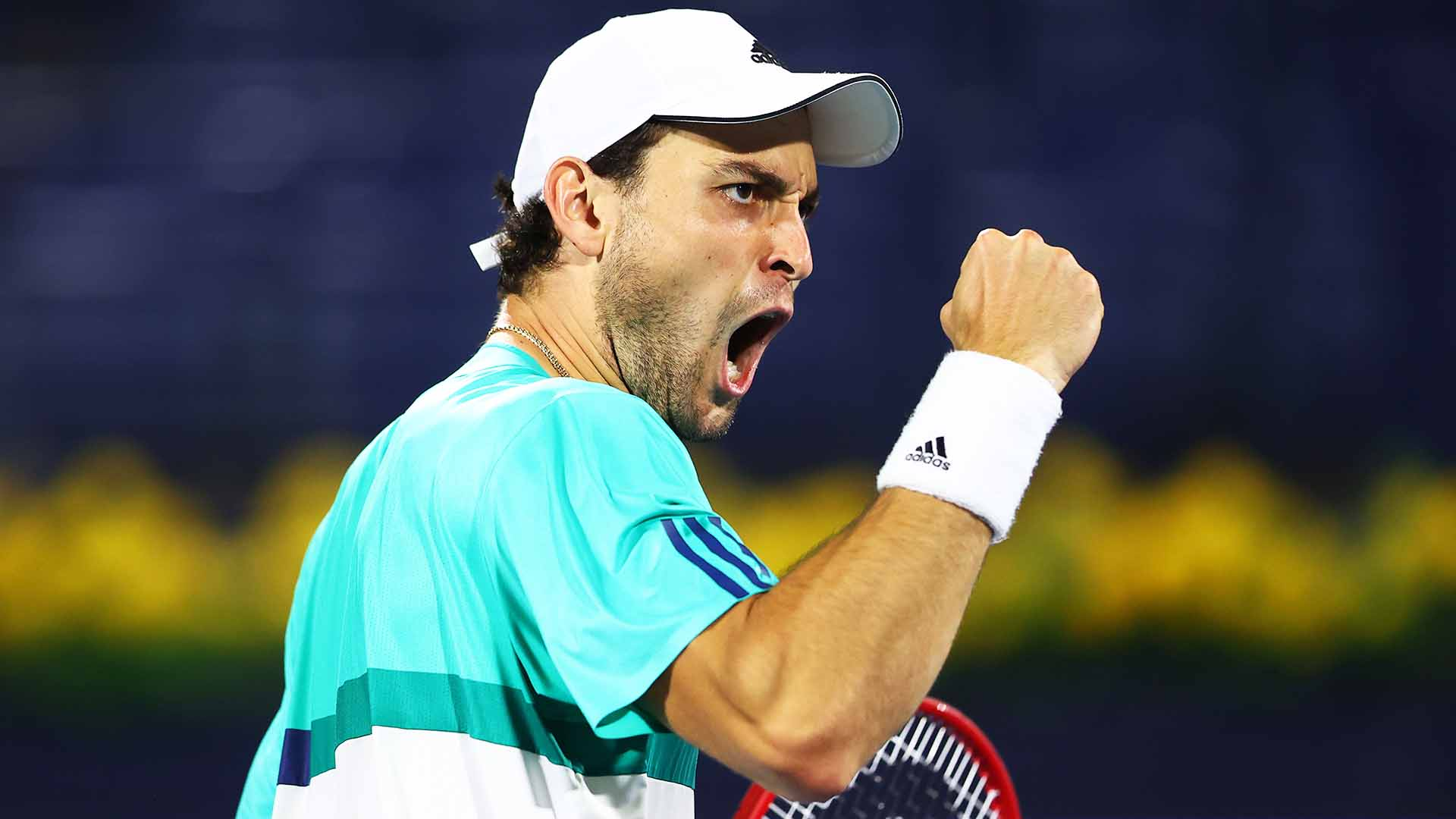 DUBAI, UNITED ARAB EMIRATES - MARCH 18: Aslan Karatsev of Russia celebrates in his Quarter-Final singles match against Jannik Sinner of Italy during Day Twelve of the Dubai Duty Free Tennis Championships at Dubai Duty Free Tennis Stadium on March 18, 2021 in Dubai, United Arab Emirates. (Photo by Francois Nel/Getty Images)