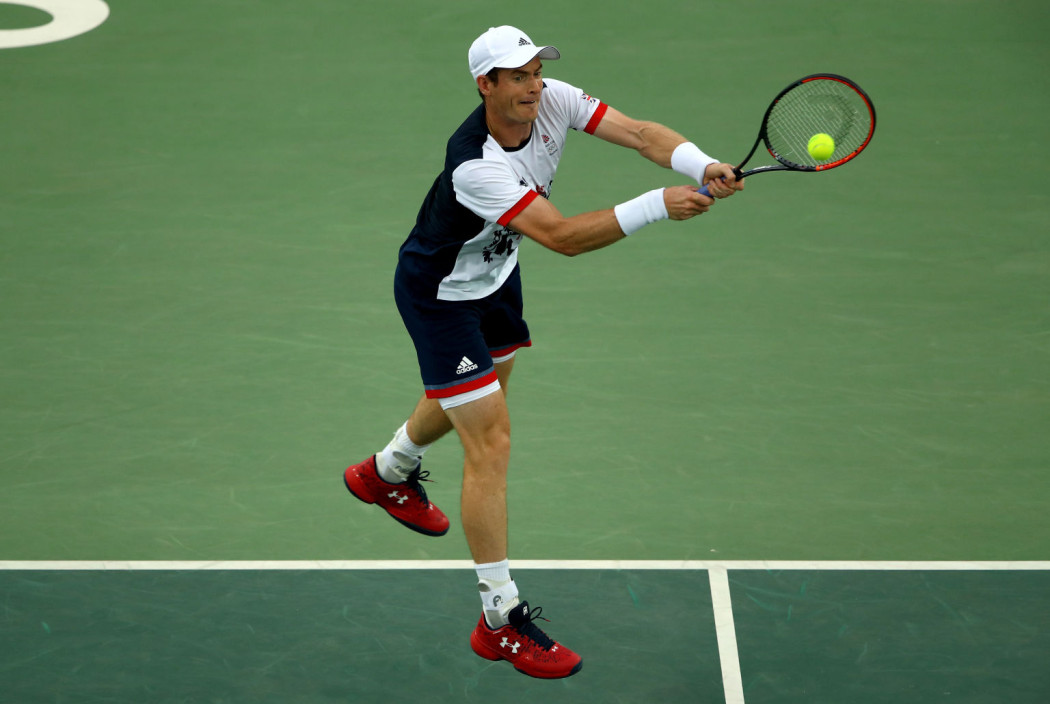 RIO DE JANEIRO, BRAZIL - AUGUST 07:  Andy Murray of Great Britain plays a backhand against Viktor Troicki of Serbia in their first round match on Day 2 of the Rio 2016 Olympic Games at the Olympic Tennis Centre on August 7, 2016 in Rio de Janeiro, Brazil.  (Photo by Clive Brunskill/Getty Images)